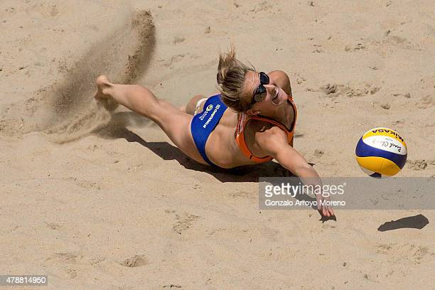 Jantine Van Der Vlist of the Netherlands dives for the ball during the FIVB Beach Volleyball World Championships female match between Brazil and The...