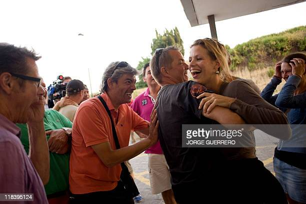 Jantje daugther of MaryAnne Goossens a Dutch woman hiker who spent 18 days trapped at the bottom of a ravine hugs relatives at the entrance of the...