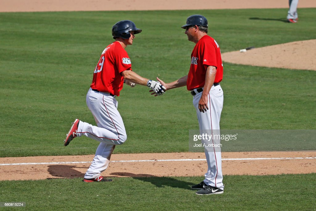 Jantzen Witte #19 is congratulated by acting third base coach Gary DiSarcina #10 of the Boston Red Sox after hitting a two run home run against the Washington Nationals in the seventh inning during a spring training game at JetBlue Park on March 30, 2017 in Fort Myers, Florida. The Red Sox defeated the Nationals 8-1.