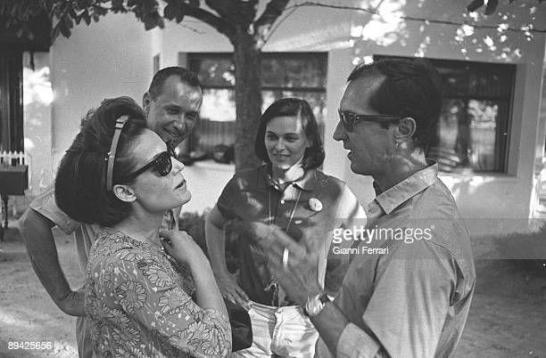January 01 1965 Saelices Cuenca Spain The bullfighter Luis Miguel Dominguin and Lucia Bose are receiving the actress and singer Carmen Sevilla in...