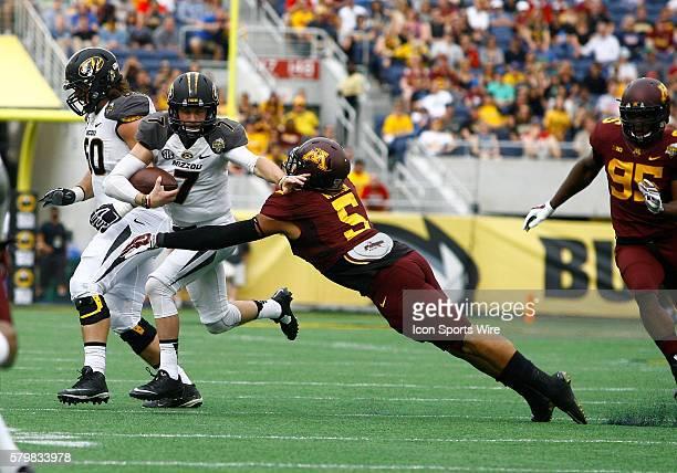 Minnesota Golden Gophers linebacker Damien Wilson tries to tackle Missouri Tigers quarterback Maty Mauk in the first half of play The Missouri Tigers...