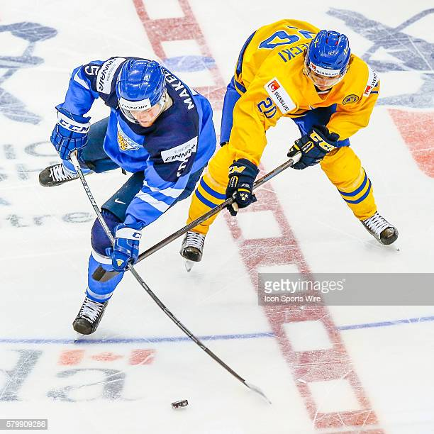 Alekski Makela of Finland fights for the puck with Adam Brodecki of Sweden during Sweden's 6-3 victory over Finland at the IIHF World Junior...