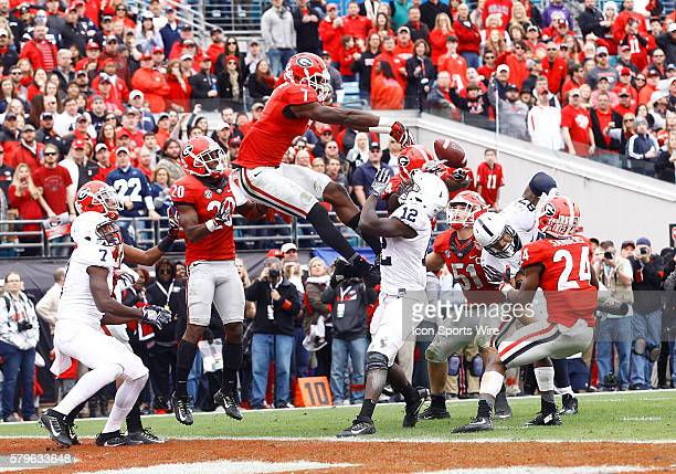 Georgia Bulldogs linebacker Lorenzo Carter knocks the ball away on a hail mary throw to end the game The Georgia Bulldogs defeated the Penn State...