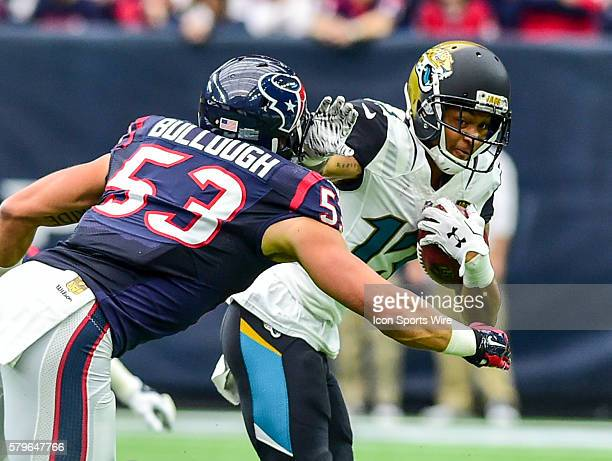 Jacksonville Jaguars Wide Receiver Rashad Greene attempts to stiff arm Houston Texans Linebacker Max Bullough during the Jaguars at Texans game at...