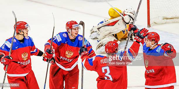 Maxim Mamin celebrates goal with Russian teammates Ziat Paigin Ivan Fishenko Dmitri Yudin during Russia's 41 victory over Sweden at the IIHF World...