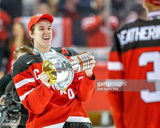 Connor McDavid of Team Canada celebrates with championship trophy following Canada's 54 victory over Russia at the IIHF World Junior Championship at...