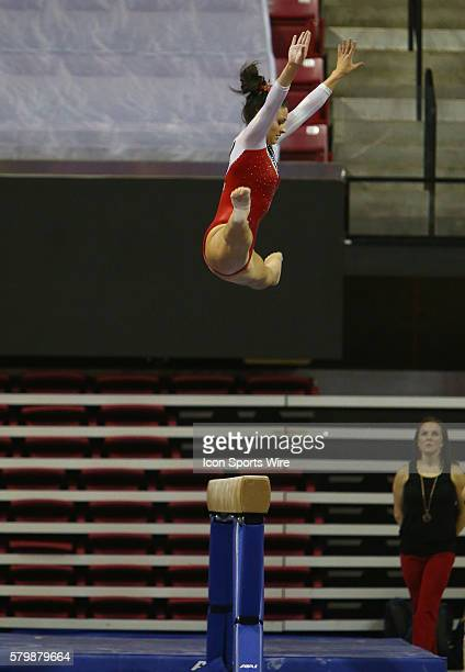 Nicole Dragon of Maryland on the balance beam during the inaugural Beauty and the Beast event combining wrestling and gymnastics at Xfinity Center in...