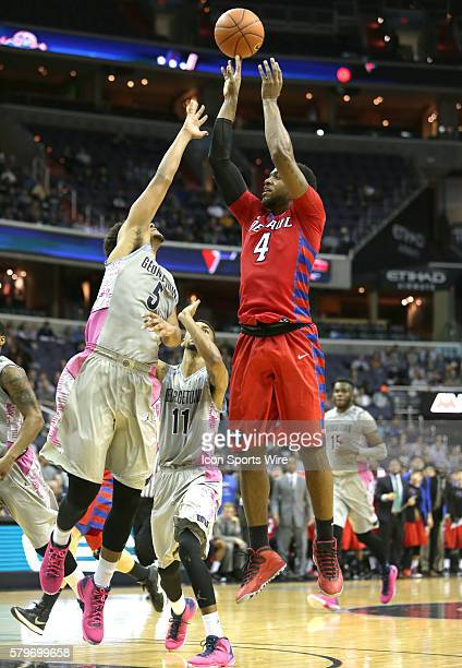 DePaul Blue Demons forward Myke Henry shoots over Georgetown Hoyas forward Reggie Cameron during a men's Big East basketball match at Verizon Center...