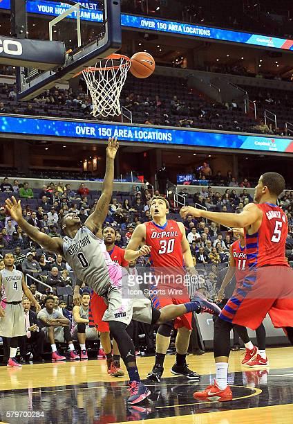 DePaul Blue Demons forward Peter Ryckbosch watches a shot by Georgetown Hoyas guard LJ Peak during a men's Big East basketball match at Verizon...