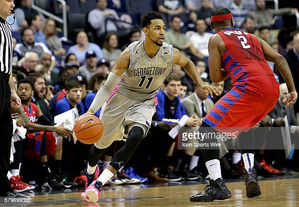 Georgetown Hoyas forward Isaac Copeland dribbles towards DePaul Blue Demons center Tommy Hamilton IV during a men's Big East basketball match at...