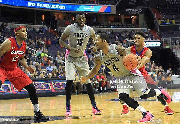 Georgetown Hoyas guard D'Vauntes SmithRivera dribbles towards DePaul Blue Demons center Tommy Hamilton IV during a men's Big East basketball match at...