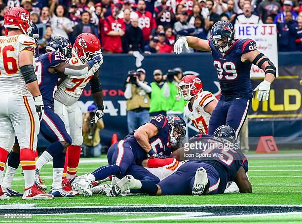 Houston Texans defensive end JJ Watt rushes in to congratulate Houston Texans defensive tackle Vince Wilfork and Houston Texans linebacker Brian...