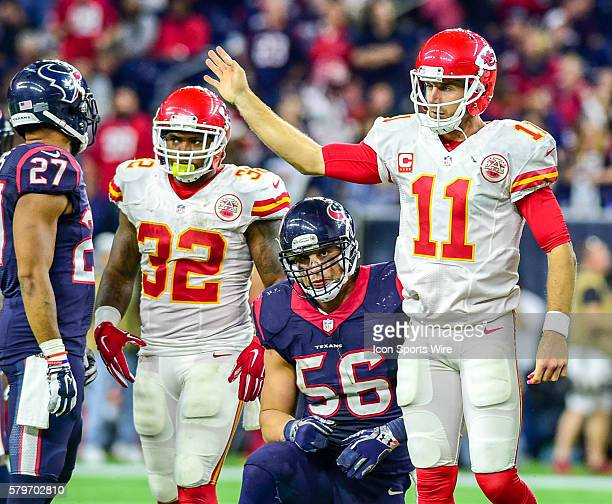 Kansas City Chiefs quarterback Alex Smith signals he slid for the first down as Houston Texans linebacker Brian Cushing looks on during the Chiefs at...