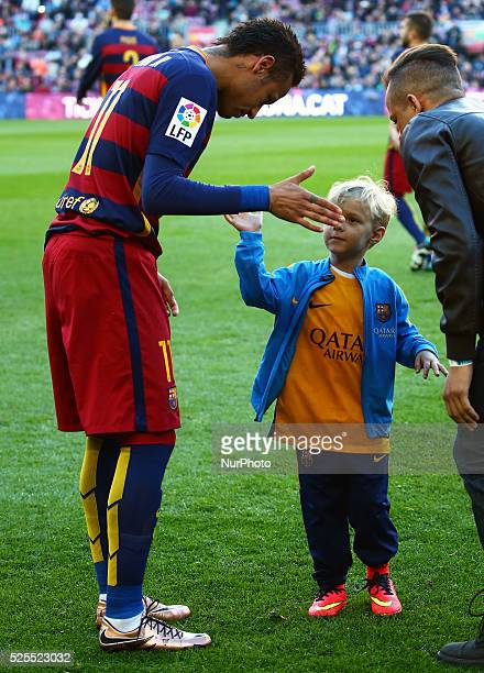 January 09- SPAIN: Neymar Jr., with his son Davi Luca, during the match between FC Barcelona and Granada CF, corresponding to the week 19 of the...