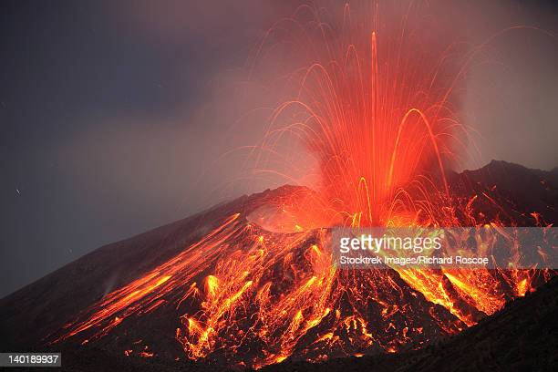 january 1, 2010 - explosive vulcanian eruption of lava on sakurajima volcano, japan. - vulkan stock-fotos und bilder