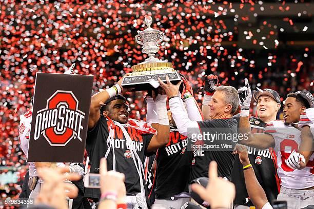 Ohio State Buckeyes running back Ezekiel Elliott and Ohio State Buckeyes head coach Urban Meyer hold up the Sugar Bowl Classic trophy during the Ohio...