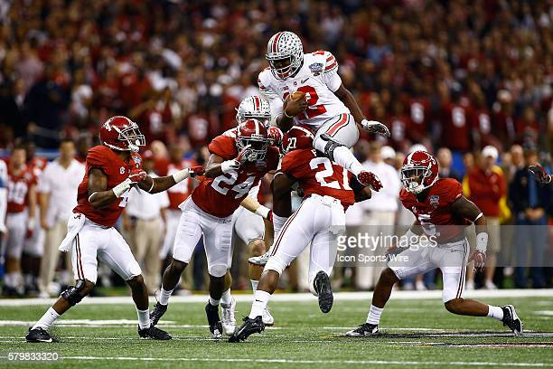 Quarterback Cardale Jones of the Ohio State Buckeyes jumps over the Alabama Crimson Tide during the Ohio State Buckeyes game versus the Alabama...