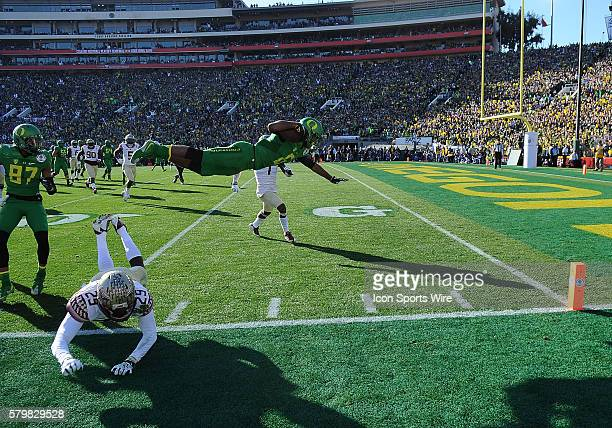 WR Charles Nelson of the Oregon Ducks leaps to the half yardline during the first half of the Florida State Seminoles game versus the Oregon Ducks in...