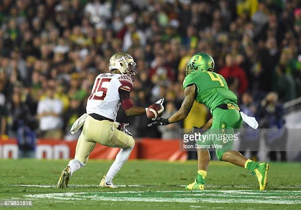 WR Travis Rudolph of the Florida State Seminoles drops the ball and has it intercepted by DB Erick Dargan of the Oregon Ducks during the Oregon Ducks...