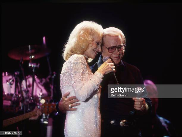 Country Music Singer Songwriter Tammy Wynette and George Jones performs at Fanfair on January 1 1995 in Nashville Tennessee