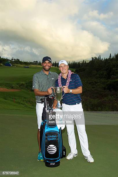 Jordan Spieth and caddie Michael Greller during the trophy presentation of the Hyundai Tournament of Champions at Kapalua Plantation Course on Maui HI