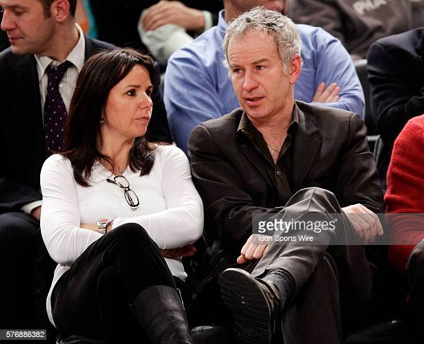 New York Knicks v Dallas Mavericks at Madison Square Garden - Former tennis pro John McEnroe and girlfriend Rocker Patty Smyth chat at tonight's game.