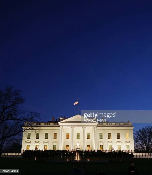 January 11, 2016 photo shows the White House at dusk in Washington, DC. US President Barack Obama is set to deliver his final State of the Union...