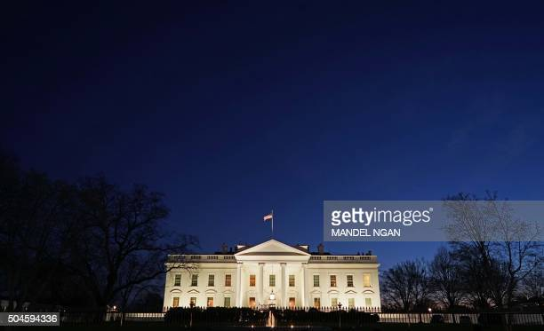A January 11 2016 photo shows the White House at dusk in Washington DC US President Barack Obama is set to deliver his final State of the Union...