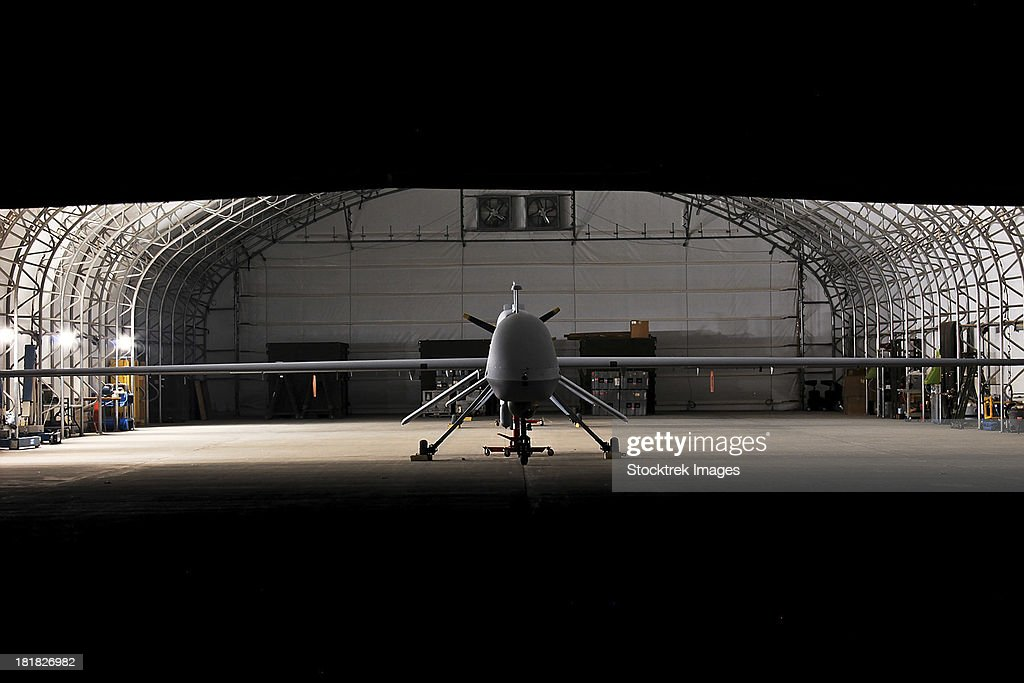 January 12, 2010 - An MQ-1C Sky Warrior unmanned aerial vehicle is parked in a hangar at Camp Taji, Iraq. : Stock Photo