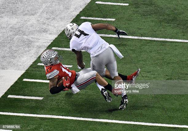 Ohio State Buckeyes running back Jalin Marshall catches a pass in mid air against Oregon Ducks defensive back Erick Dargan during the Ohio State...