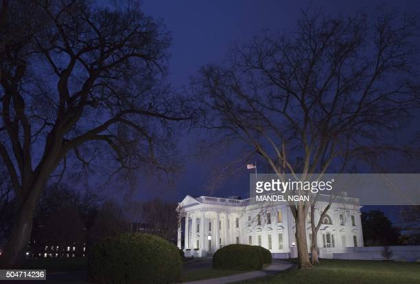 January 12 2016 photo shows the White House at dusk in Washington DC US President Barack Obama is set to deliver his final State of the Union address...