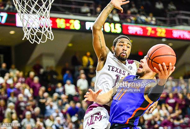 Texas AM Aggies guard Anthony Collins prepares to block a shot attempt by Florida Gators guard Chris Chiozza during the Florida Gators vs Texas AM...