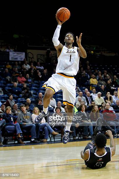 Toledo Rockets guard Jonathan Williams goes in for a layup during a regular season basketball game between the Northern Illinois Huskies and the...