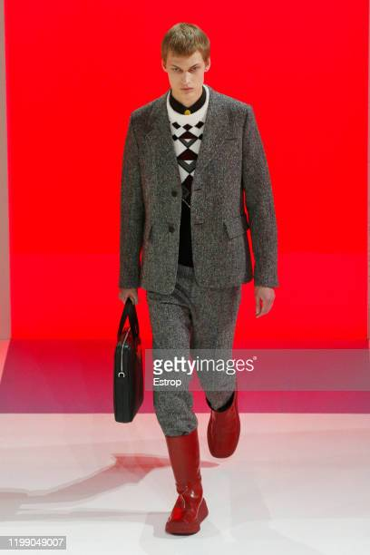 January 12: A model walks the runway at Prada show during Milano Fashion Week Men's at Fondazione Prada on January 12, 2020 Milano, Italy.