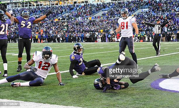 Baltimore Ravens inside linebacker Ray Lewis raises his arms to celebrate their 2013 win over the Houston Texans after free safety Ed Reed knocked...