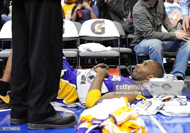 Los Angeles Lakers guard Kobe Bryant rests on the floor to help his back in which he has been experiencing spasms during an NBA game between the Los...