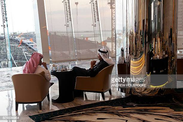 January 15 2012 Hotel guests and visitors eating drinking having coffee or tea at The Jumeriah Hotel lobby lounge The Jumeriah Hotel is part of the...