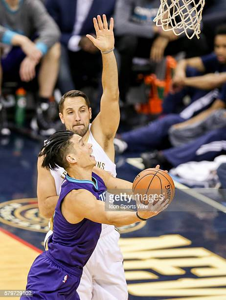 Charlotte Hornets guard Jeremy Lin shoots against New Orleans Pelicans forward Ryan Anderson during the NBA game between the Charlotte Hornets and...