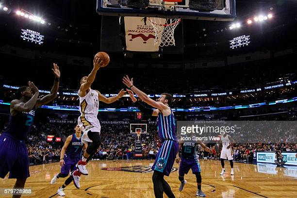 New Orleans Pelicans guard Eric Gordon shoots a lay up against Charlotte Hornets forward Marvin Williams during the NBA game between the Charlotte...