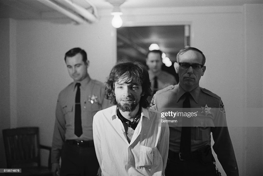 Charles Manson, hippie cult leader, is brought into court 1/15 to hear the final arguments from the prosecution in the Tate-LaBianca murders in which he and three female defendants are charged with murder. The Manson trial went to the jury late 1/15 following seven months of courtroom proceedings. UPI b/w photograph.