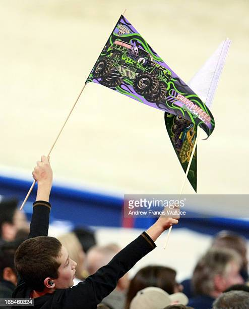 January 16 2010 A young fan waves Grave Digger pennants in the air during a Monster Truck event at the Rogers Centre