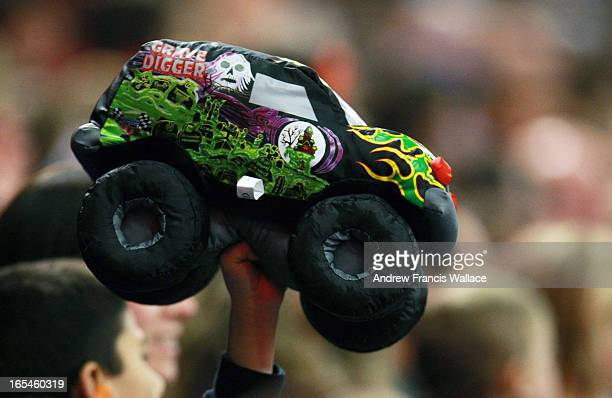 January 16 2010 A young fan waves his stuffed Grave Digger toy in the air during a Monster Truck event at the Rogers Centre