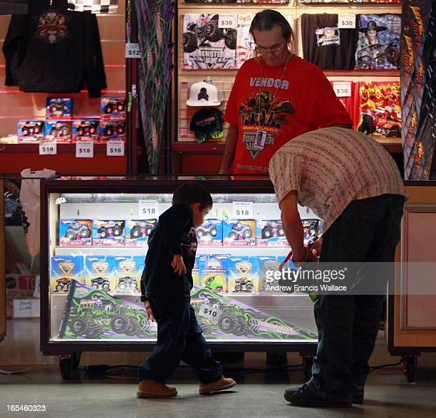 January 16 2010 Zander Nash picks out a souvenir with his dad Geoff at a Monster Truck event at the Rogers Centre