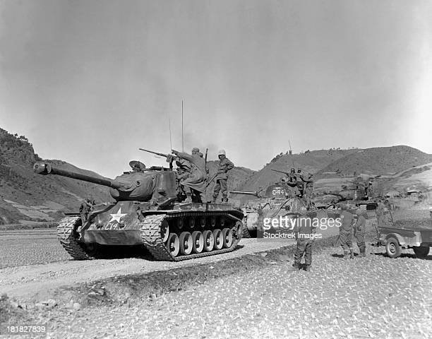 january 17, 1951 - tank-led patrol of leathernecks hunt down north korean guerrillas somewhere in the mountainous region of korea. - korean_war stock pictures, royalty-free photos & images