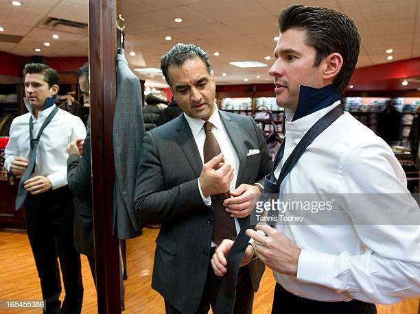January 17 2011Robert Jones' sales manager Saman Shams teaches Matt Dusk how to tie a single knot tie for a slimer look with his Palizileri Cerimonia...