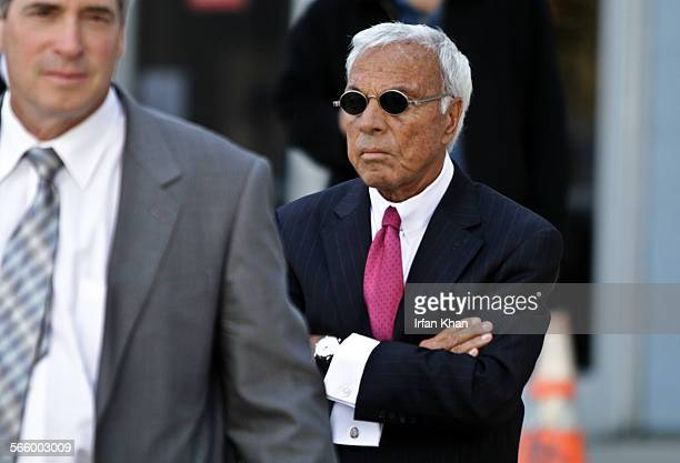 VAN NUYS CA January 18 2010 Countrywide Financial former Chief Executive Officer Angelo Mozilo in dark glasses emerges from Superior Court in Van...