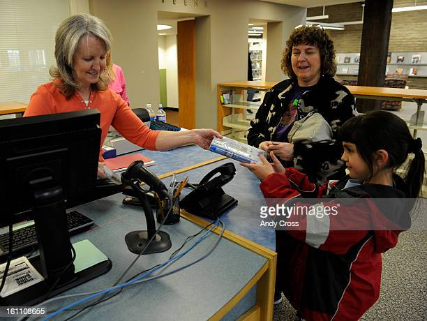 AURORA CO January 18th 2011 Mission Viejo Library clerk Debra Jacobs left hands Megan Apodaca 8yearsold a book that she checked out with her mother...