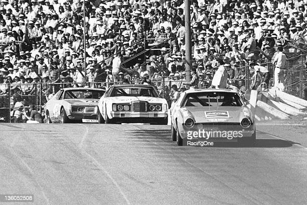 Bobby Allison in the Roger Penske AMC Matador leads the Mercury of David Pearson and the Dodge of Richard Petty on his way to victory in the Winston...