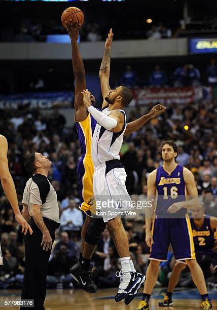 Dallas Mavericks center Tyson Chandler and Los Angeles Lakers center Andrew Bynum go up for the tip off in an NBA game between the Los Angeles Lakers...