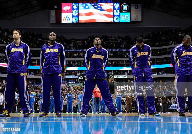 Los Angeles Lakers shooting guard Kobe Bryant and Lakers team mates observe the National Anthem before an NBA game between the Los Angeles Lakers and...
